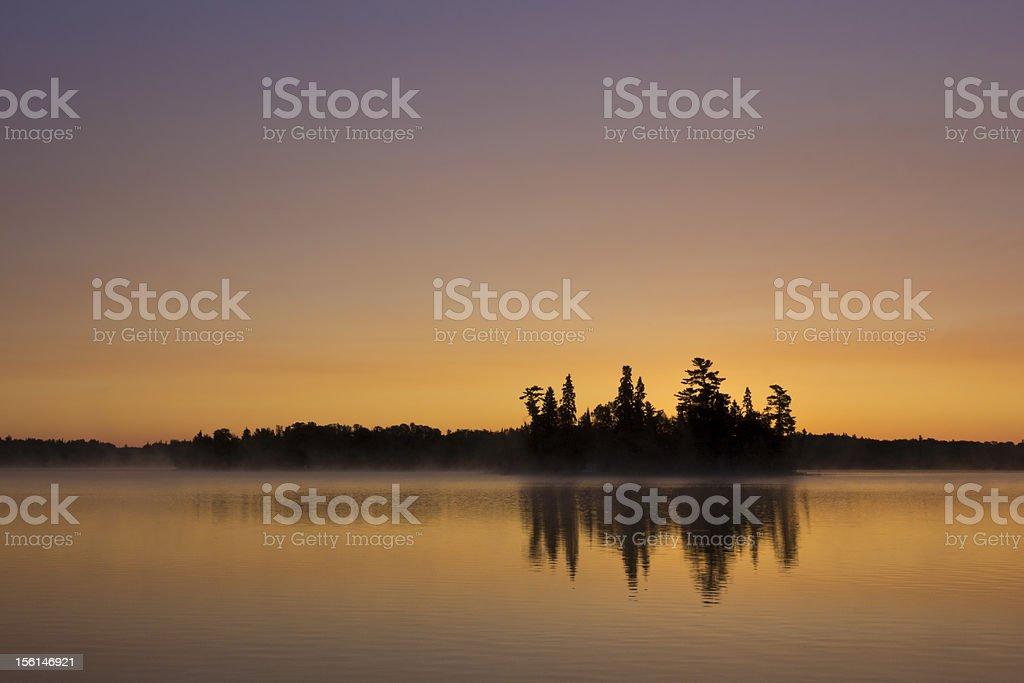 Misty lake at sunrise royalty-free stock photo