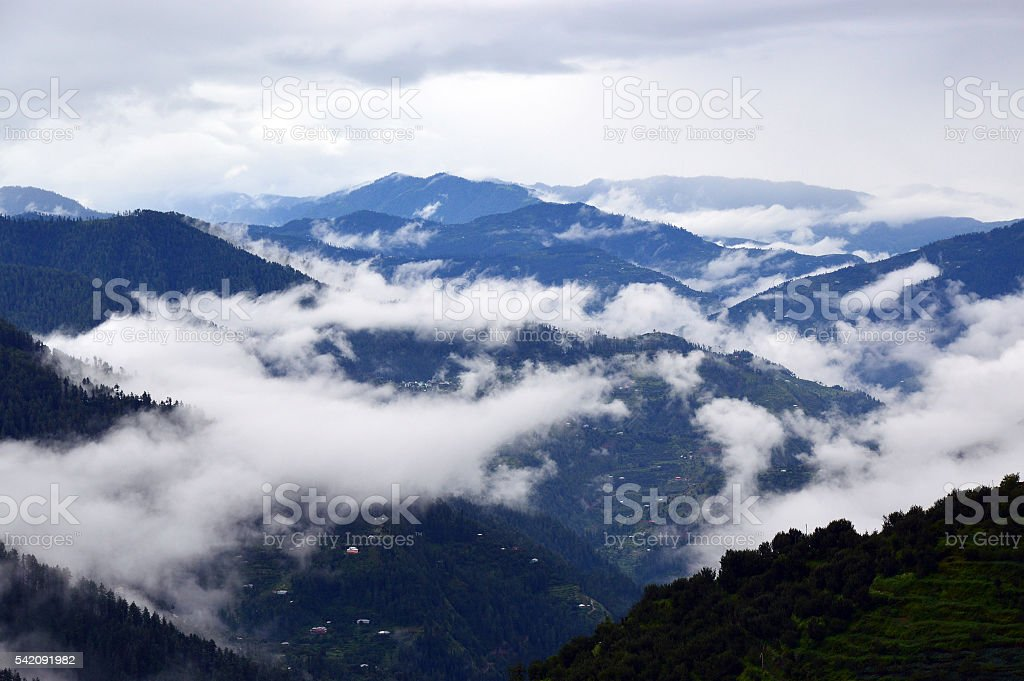 Misty morning over the Himalayan mountains stock photo