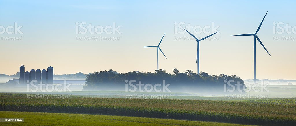 Misty Morning; Rural Wisconsin Landscape Panorama With Wind Turbines royalty-free stock photo