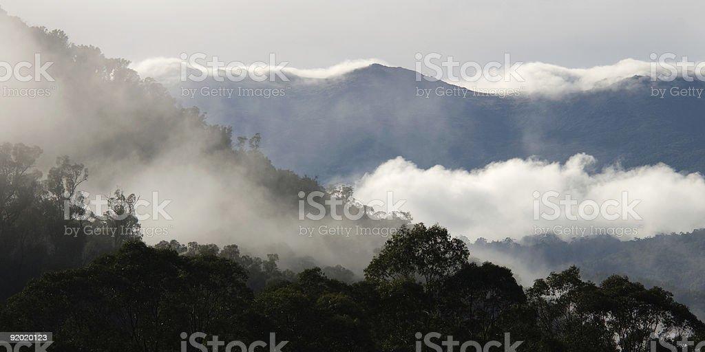 Misty Mountain Layers with Cloud on Ridges, Snowy Mountains, Australia stock photo