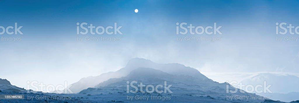 Misty mountain morning dramatic winter peaks royalty-free stock photo