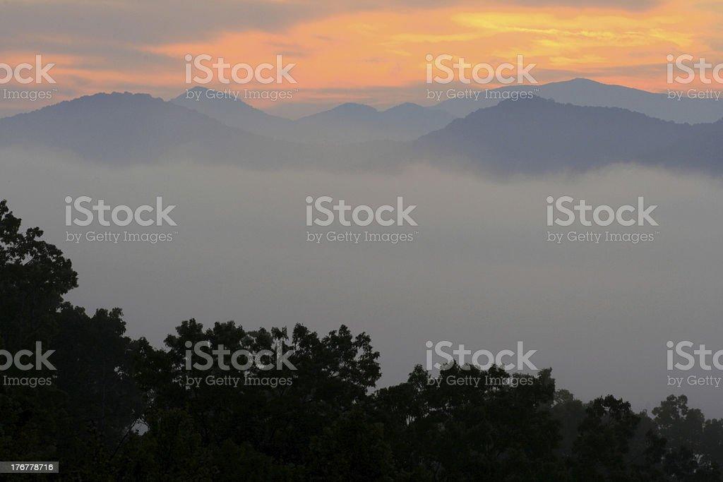misty mountain sunrise stock photo