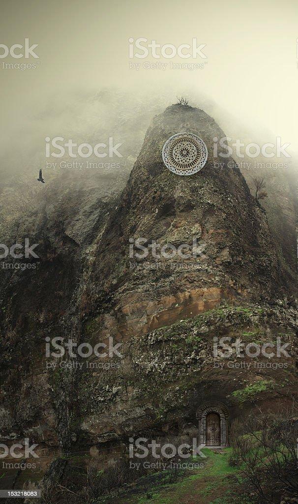 Misty mountain with round symbol stock photo