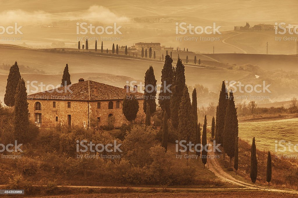 Misty Rolling Landscape at Dawn, Tuscany, Italy stock photo