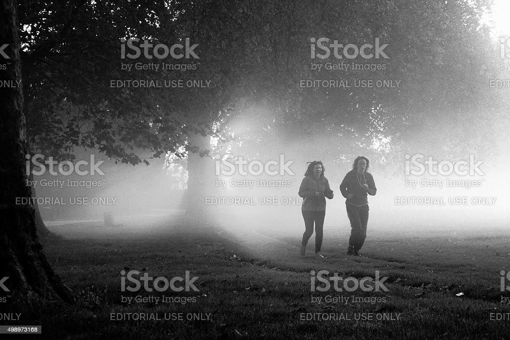 Misty Runners stock photo