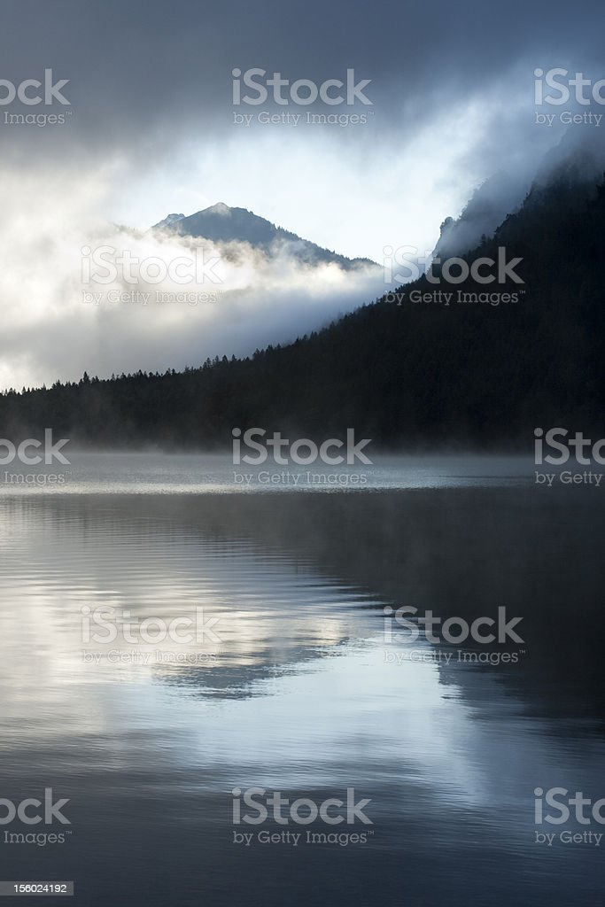 Misty sunrise at Lake Plansee - vertical royalty-free stock photo