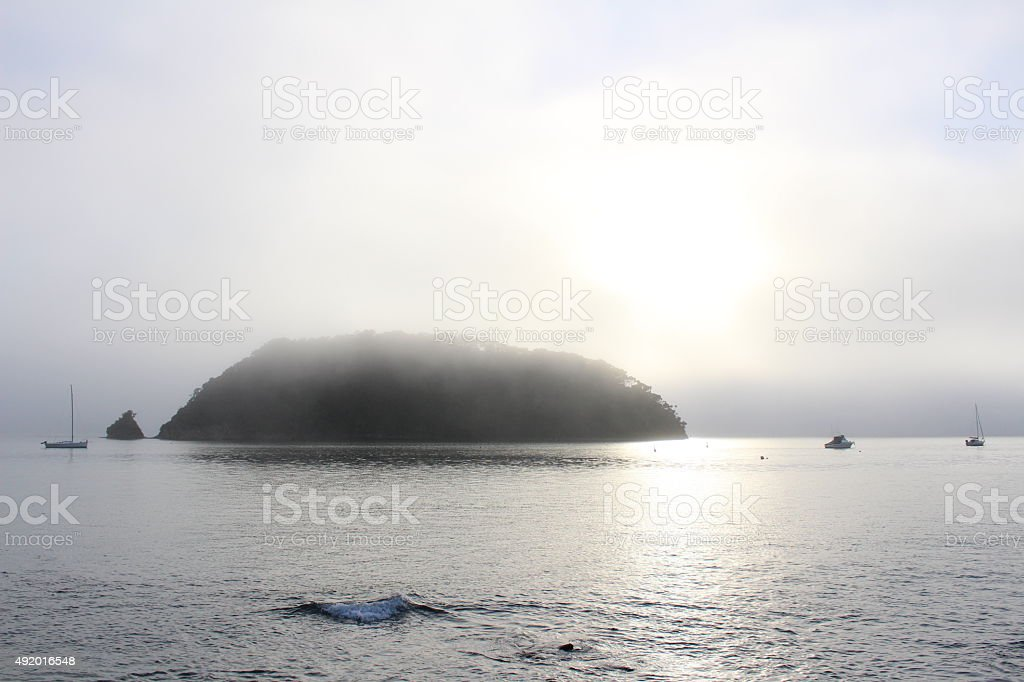 Misty sunrise at sea stock photo