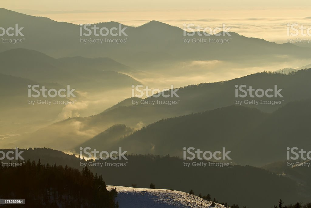 Misty sunrise in panoramic view of middle range mountain royalty-free stock photo