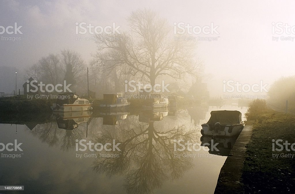 misty sunrise on the river stock photo