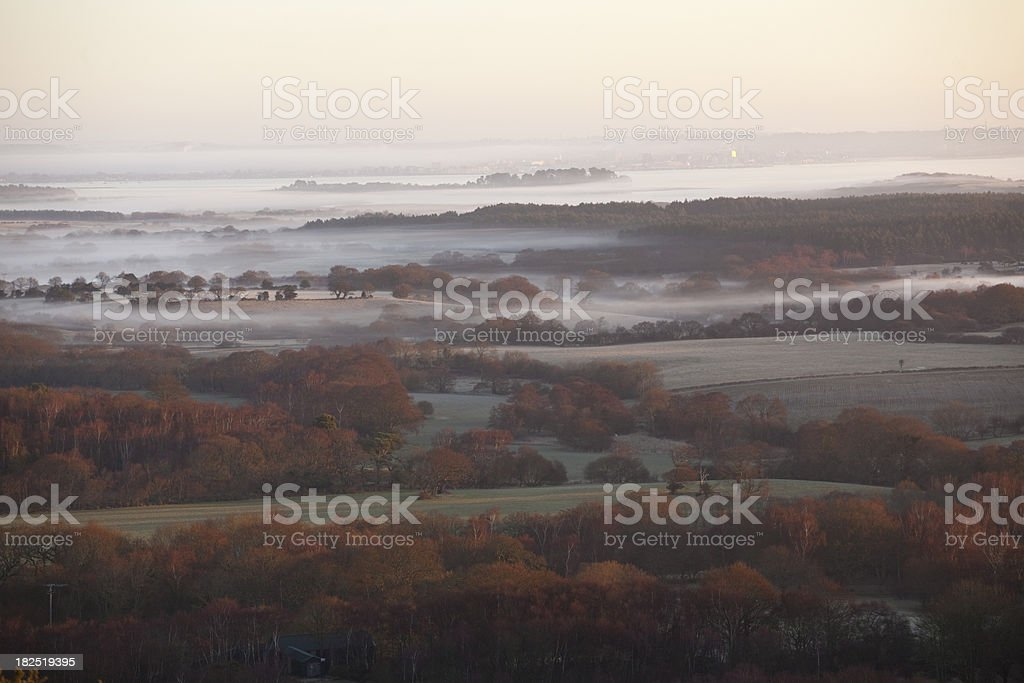 Misty sunrise over Arne and Poole Harbour stock photo