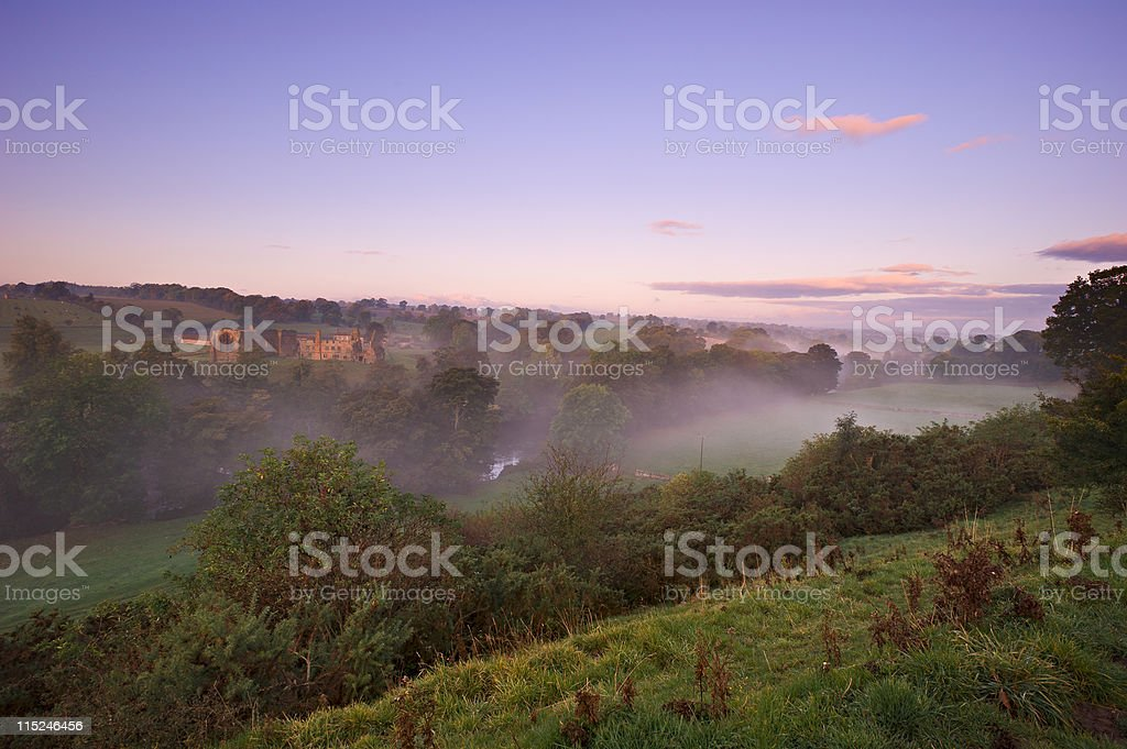 Misty Sunrise over Egglestone abbey stock photo
