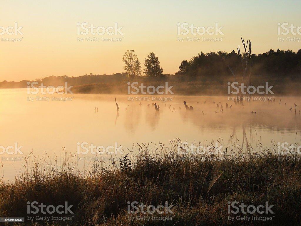 Misty sunrise over Lake Zorinsky stock photo