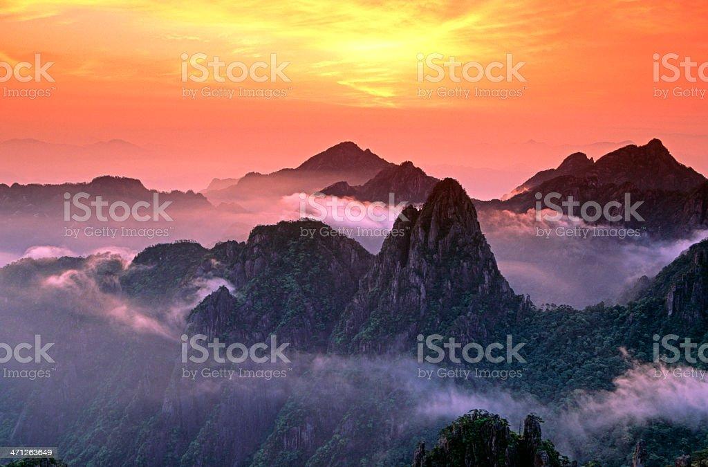 misty sunrise over Mount Huangshan stock photo