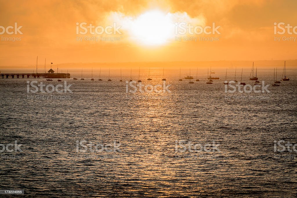 Misty sunset over harbour stock photo
