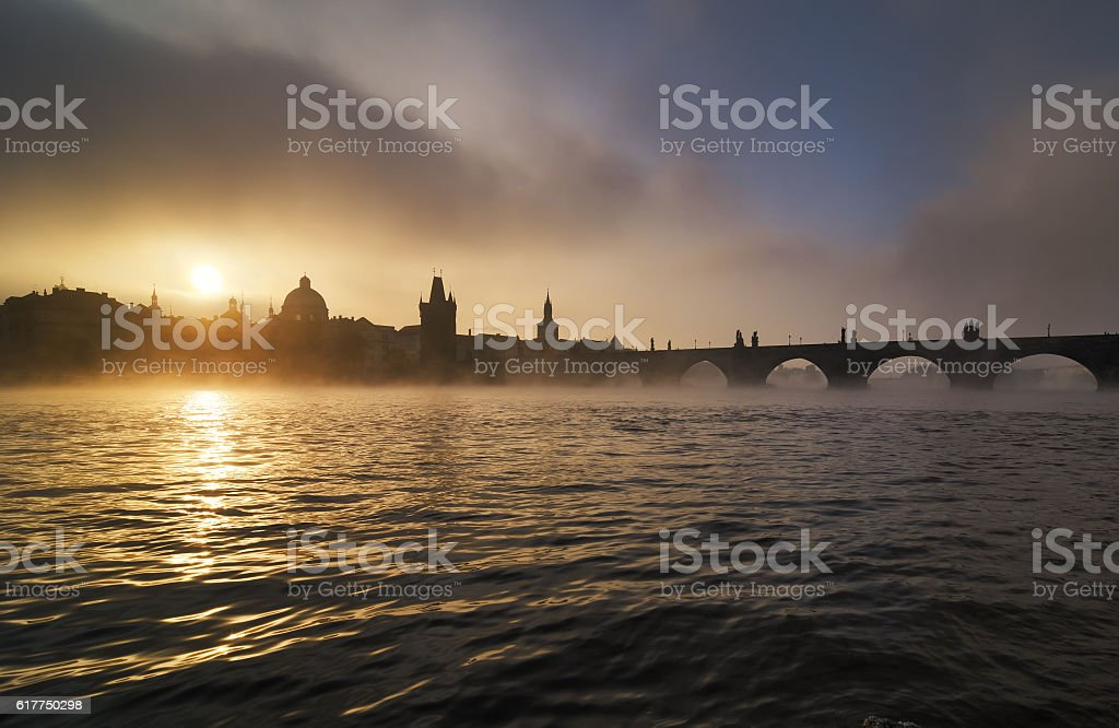 Misty towers of Charles bridge, Prague, Czech republic stock photo