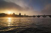 Misty towers of Charles bridge, Prague, Czech republic