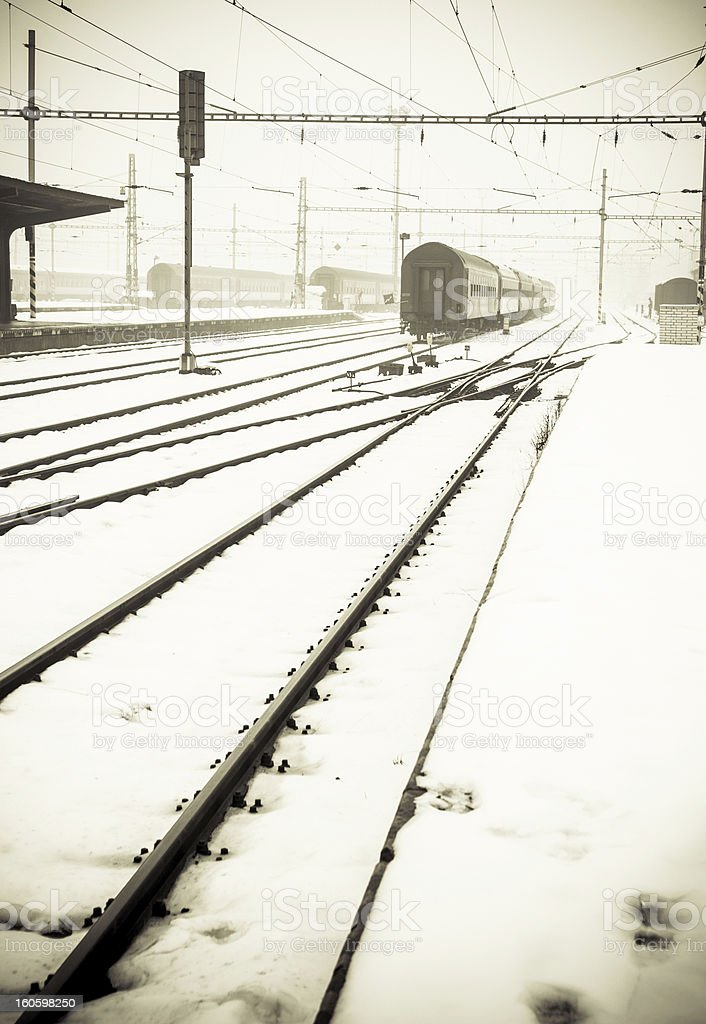 Misty train station covered by snow stock photo