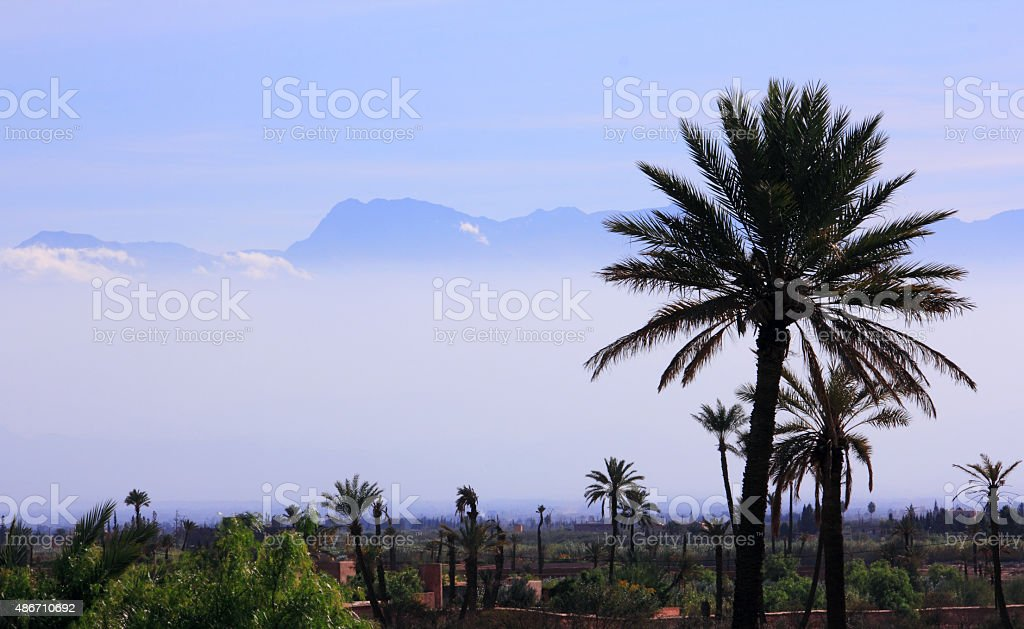 Misty valley below the Atlas Mountains, Morocco. stock photo