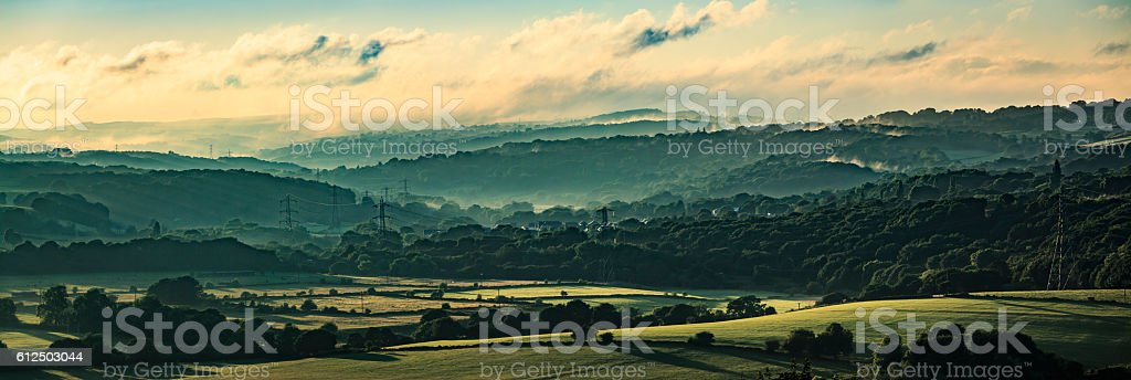 Misty valley in Leeds, Yorkshire with electricity pylons stock photo