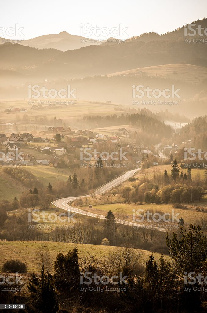 Misty view of the Pieniny mountains and country road, Poland stock photo