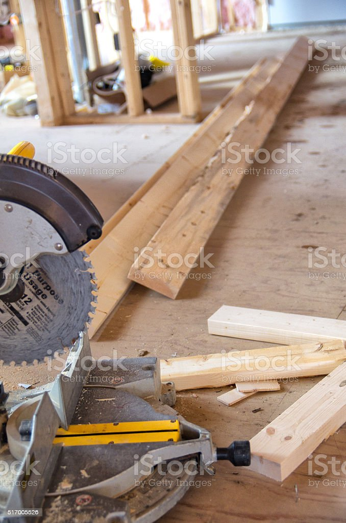 Mitre Saw During House Construction stock photo