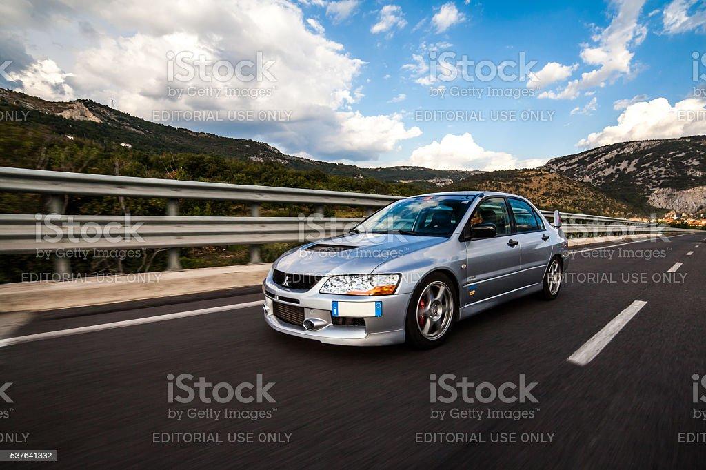 Mitsubishi EVO 8 on highway stock photo