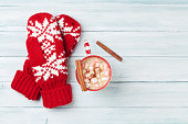 Mittens and hot chocolate with marshmallow