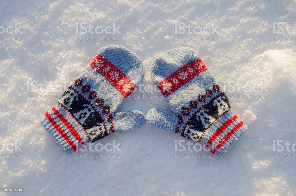 mittens in snow stock photo