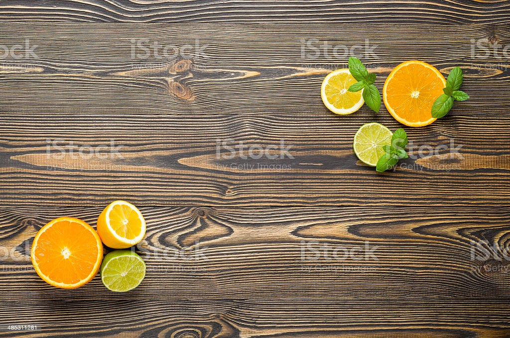 Mix citrus fresh fruit on the white wooden table royalty-free stock photo