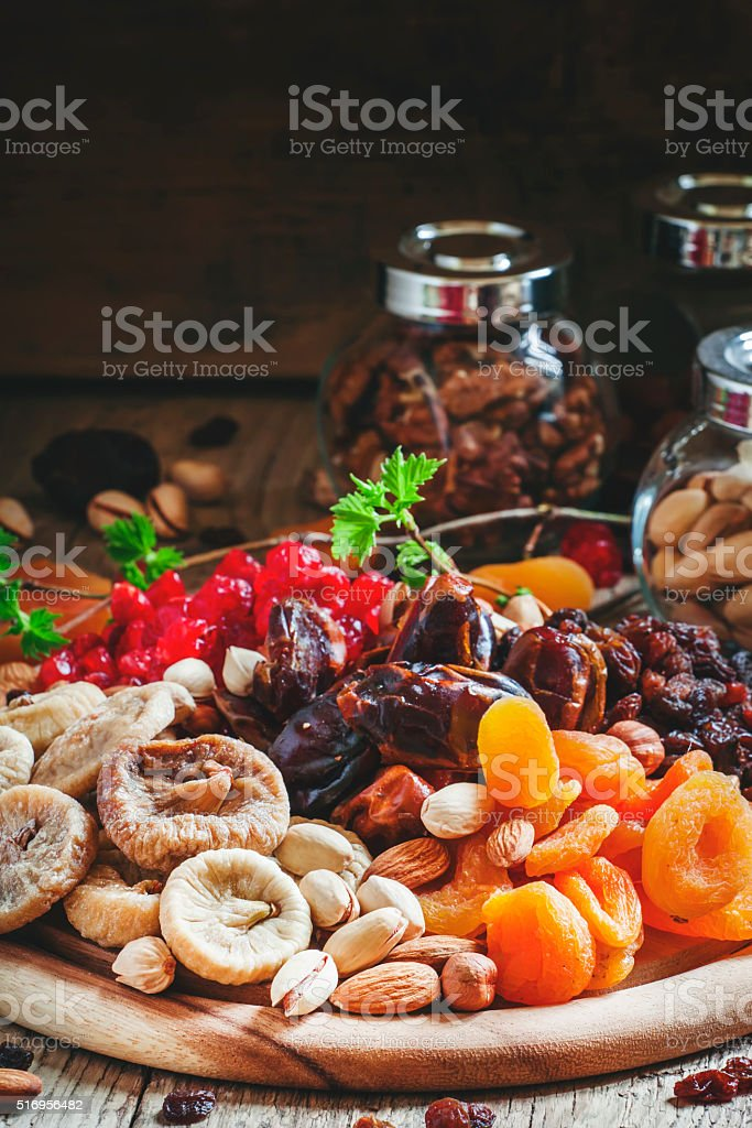 Mix dried fruits and nuts, healthy diet, eating lean stock photo