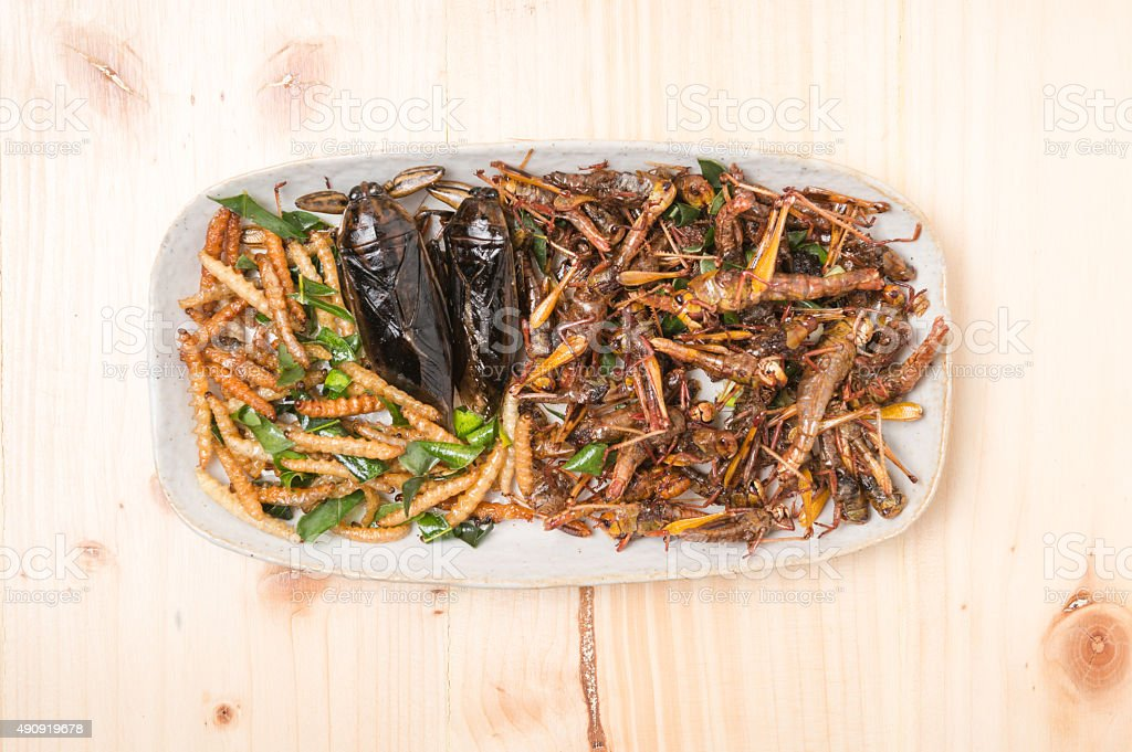 Mix insect fried on wooden background stock photo