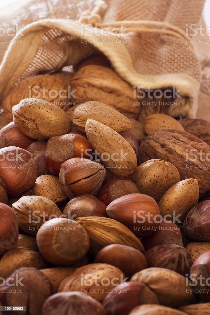 Mix nuts in sack. Almonds, hazelnuts royalty-free stock photo