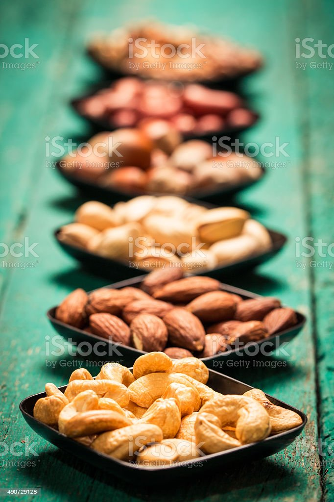 Mix nuts on wooden table,healthy vegan food. stock photo