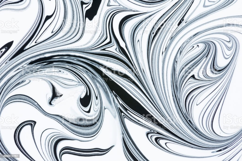 Mix of a white and black paint, closeup. stock photo