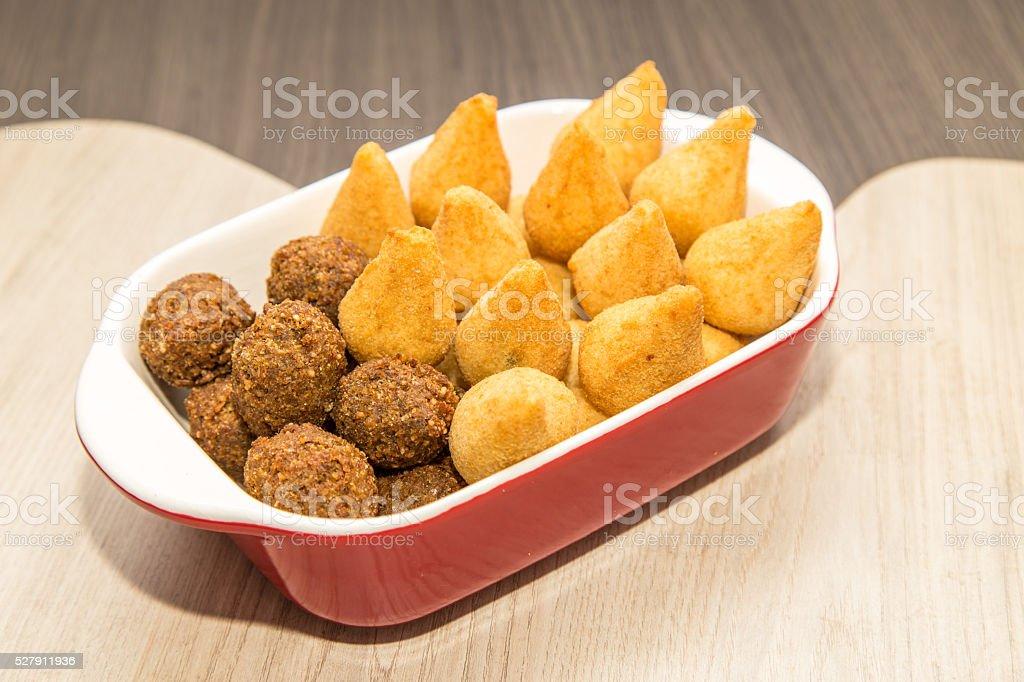 Mix of brazilian fried mini snacks stock photo