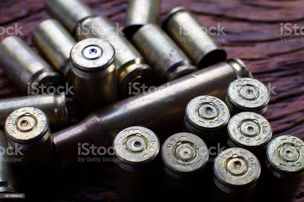 Mix of empty bullets 9mm stock photo
