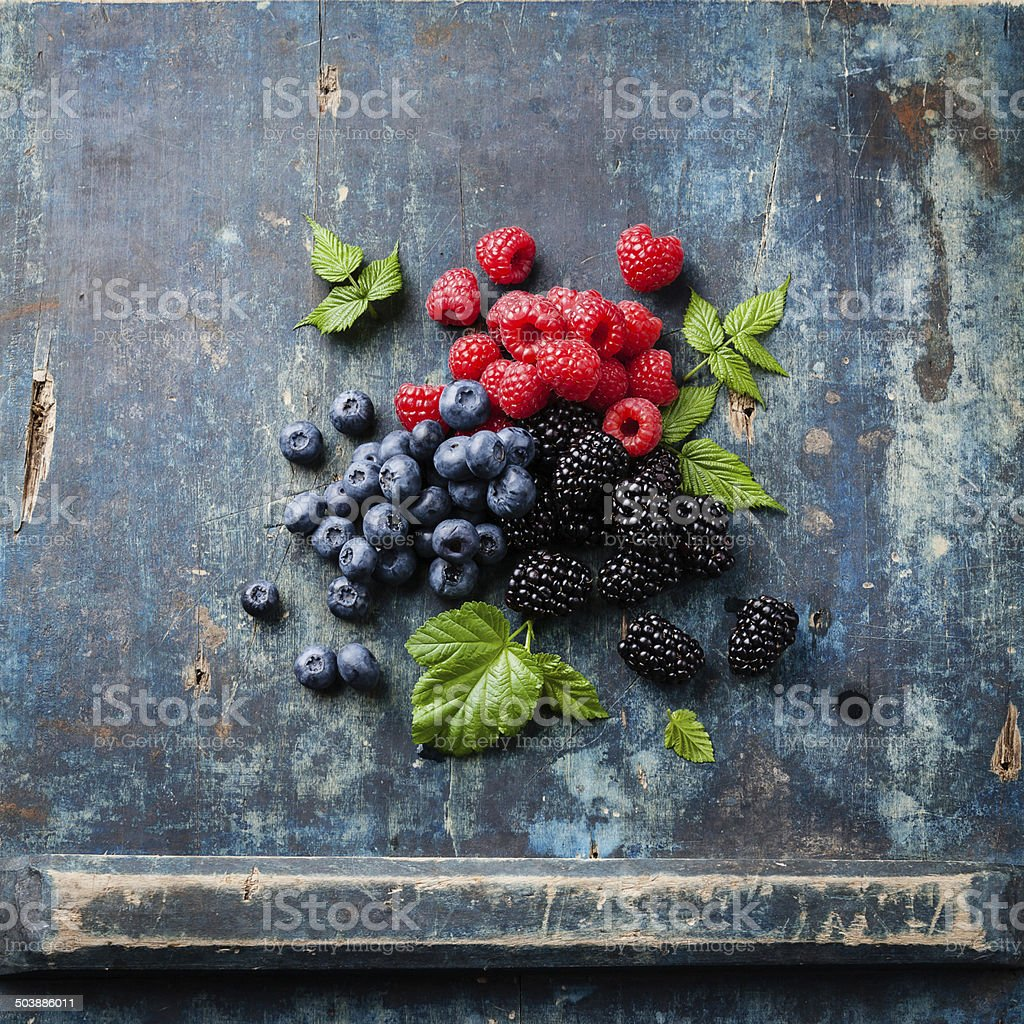 Mix of fresh berries with leaves stock photo