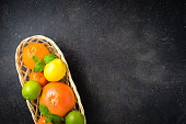 Mix of fresh citrus fruits in wicker basket