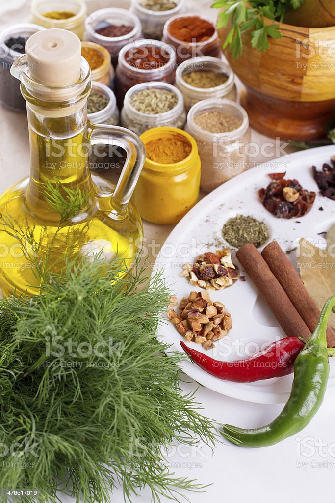 Mix of fresh herbs, spices and oil royalty-free stock photo