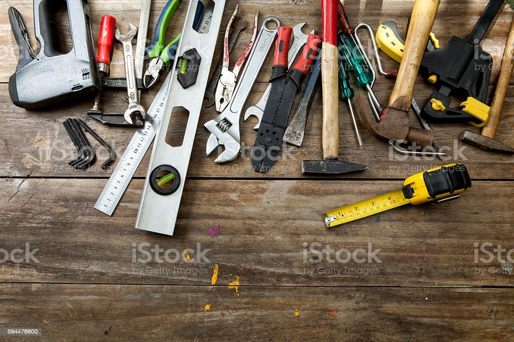 Mix of hand tools over wood. With copy space stock photo