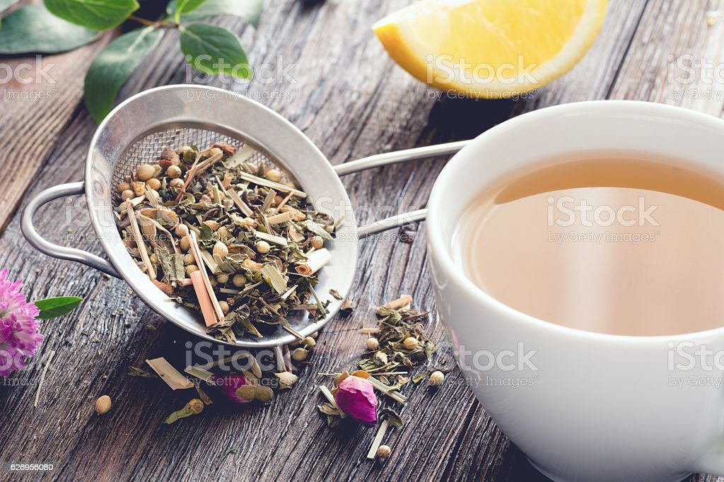 Mix of herbal tea and cup of tea stock photo