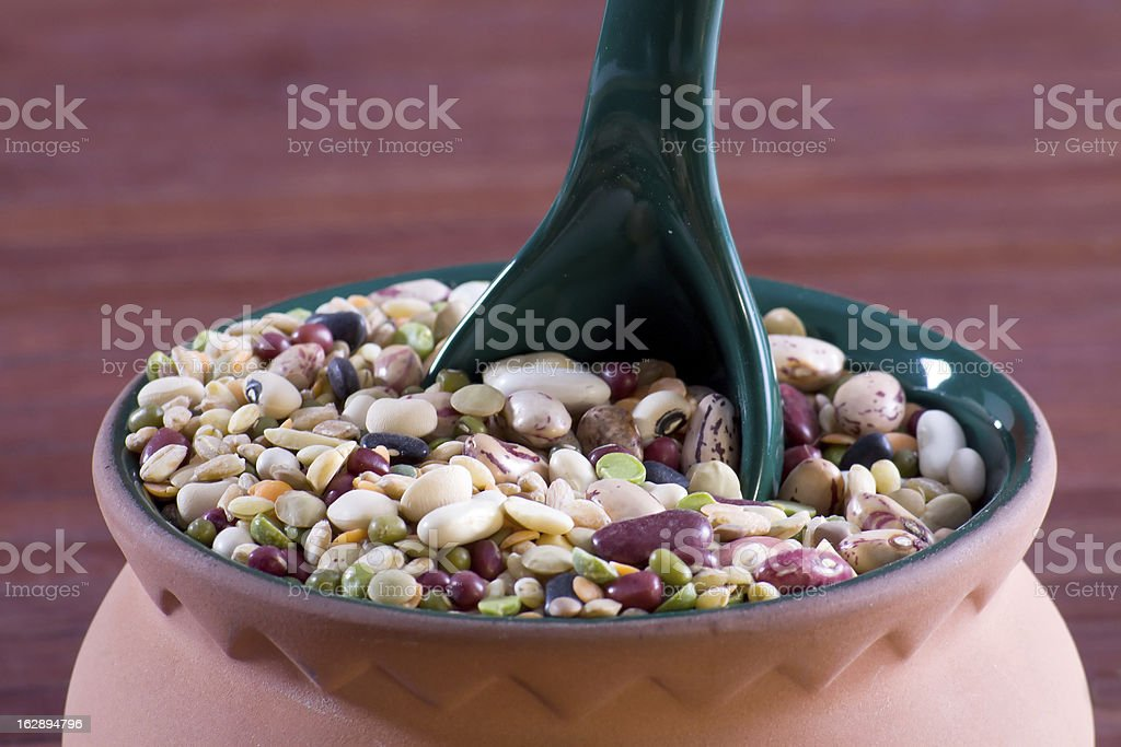 Mix of legumes in an earthenware jar royalty-free stock photo