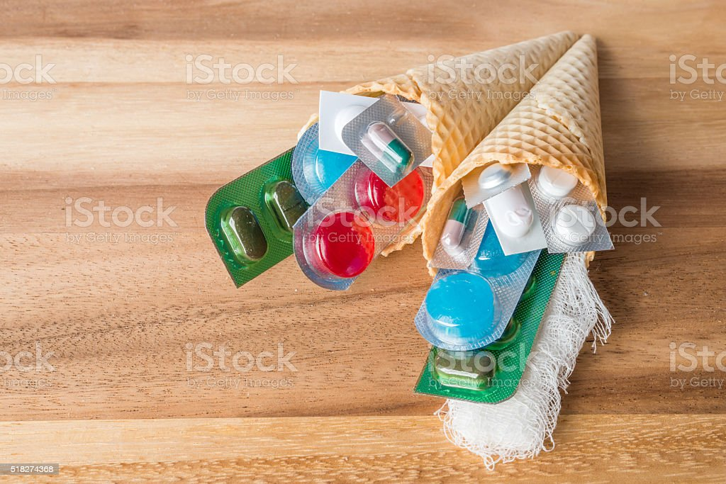 Mix of medicines and pills in wafer cones stock photo