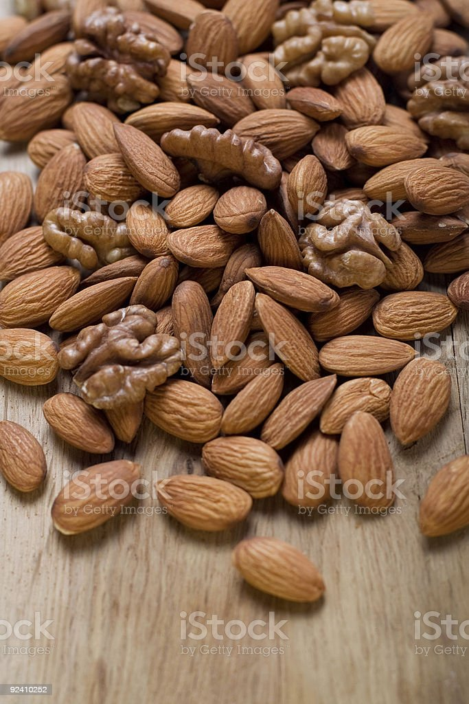 Mix of nuts on wood table stock photo