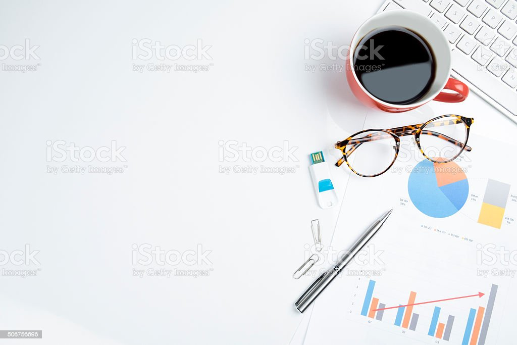 Mix of office supplies and gadgets on a white table. stock photo