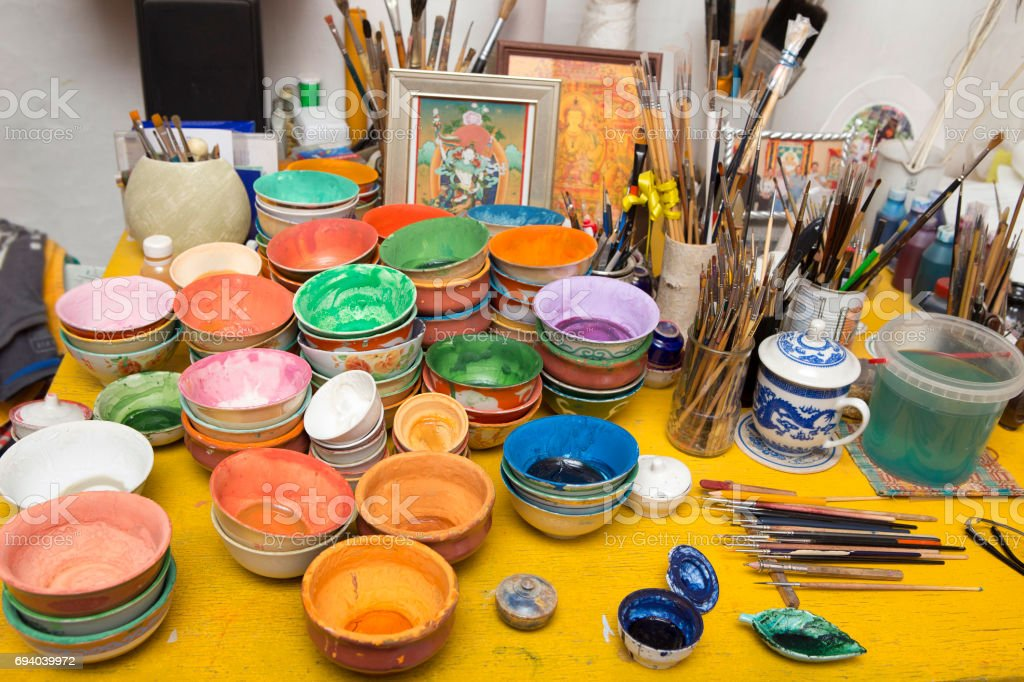 Mix of panits and paintbrushes stock photo