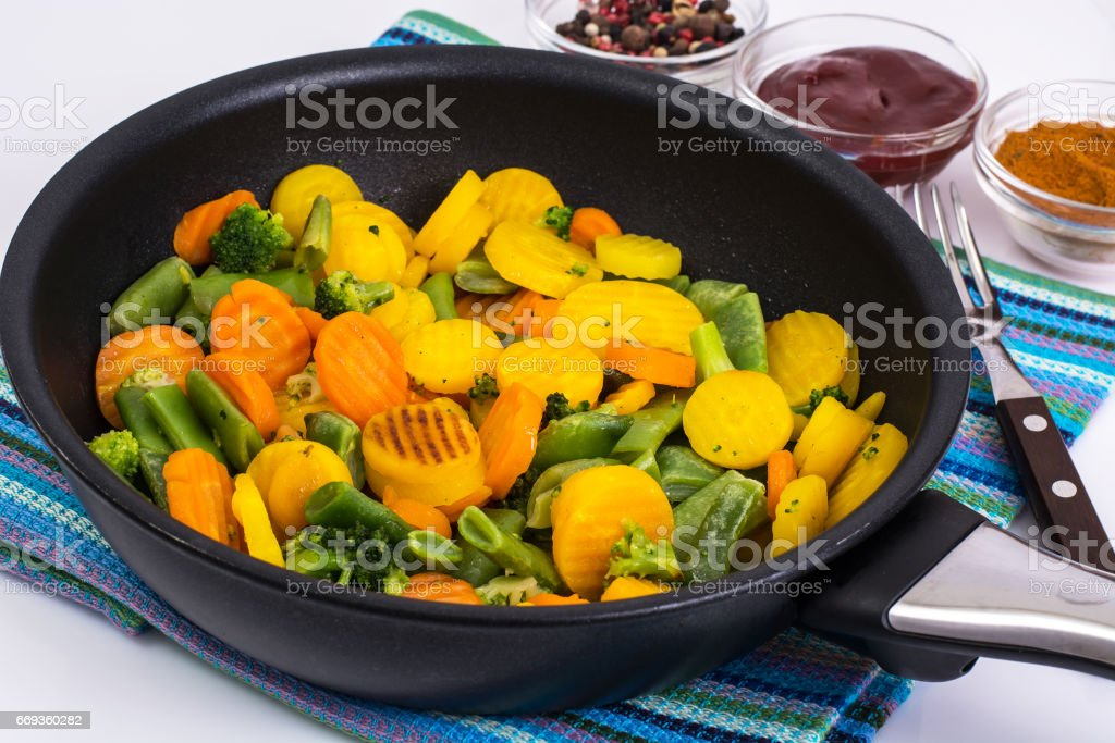 Mix of roasted vegetables in pan stock photo