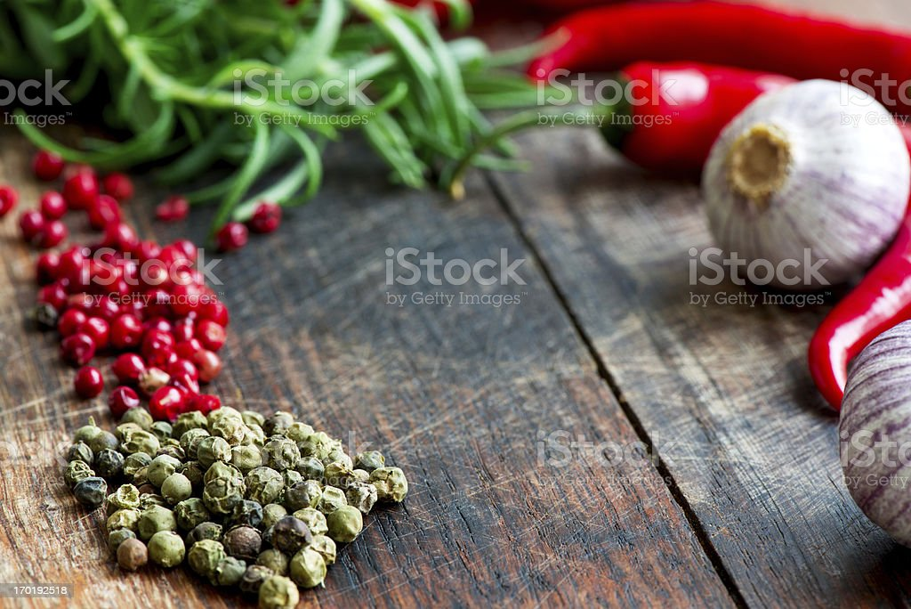 Mix of spices herbs and vegetables on table close up stock photo