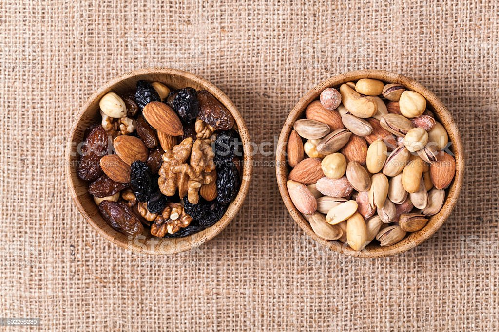 mix of various nuts on wood background stock photo