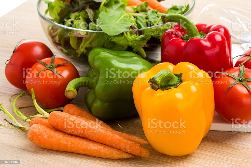 Mix of vegetables on salad on the wood table background. stock photo